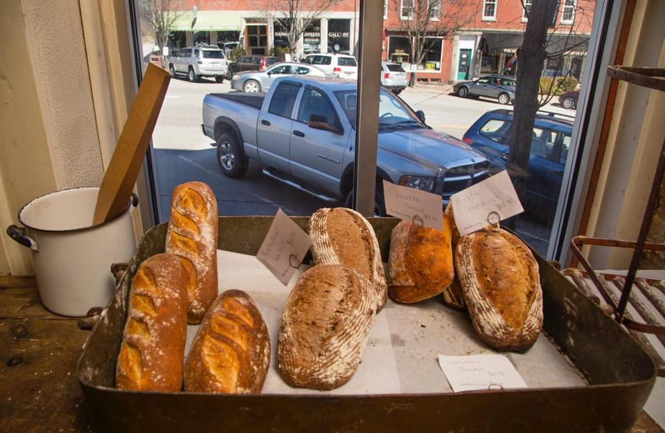 WISCASSET, ME - APRIL 5: Cars are parked streetside, outside Treats Bakery window, in the Rt 1 Maine town of Wiscasset. The Maine Department of Transportation's plan to eliminate on-street parking in the town, in order to widen the travel lanes and reduce bottlenecks during the summer tourist season, is being met by opposition of many business owners, including Treats owner Stacy Linehan. (Carl D. Walsh for The Boston Globe)